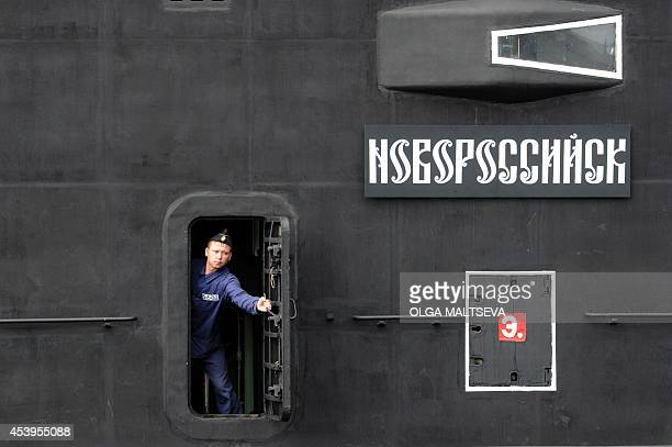 A sailor closes a door of the newly built 'Novorossiysk' B261 multipurpose dieselelectric submarine in Saint Petersburg on August 22 2014 The new...