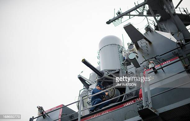 A sailor conducts maintenance on the Phalanx CIWS closein weapon system aboard the Arleigh Burkeclass guided missile destroyer USS Stout at Naval...