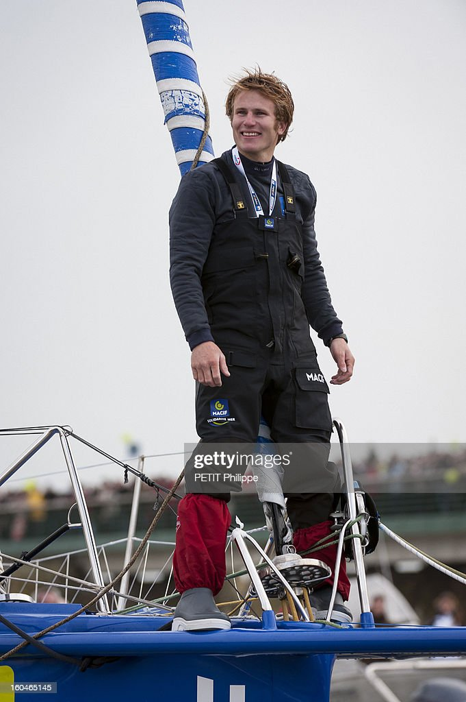 Sailor Francois Gabart arrives in port after winning the Vendee Globe 2013 record with his boat Macif on January 27, 2013 in Sables d'Olonne,France. He won the Vendee Globe 2013, smashing the record round the world solo in 78 days 2 hours and 16 minutes.