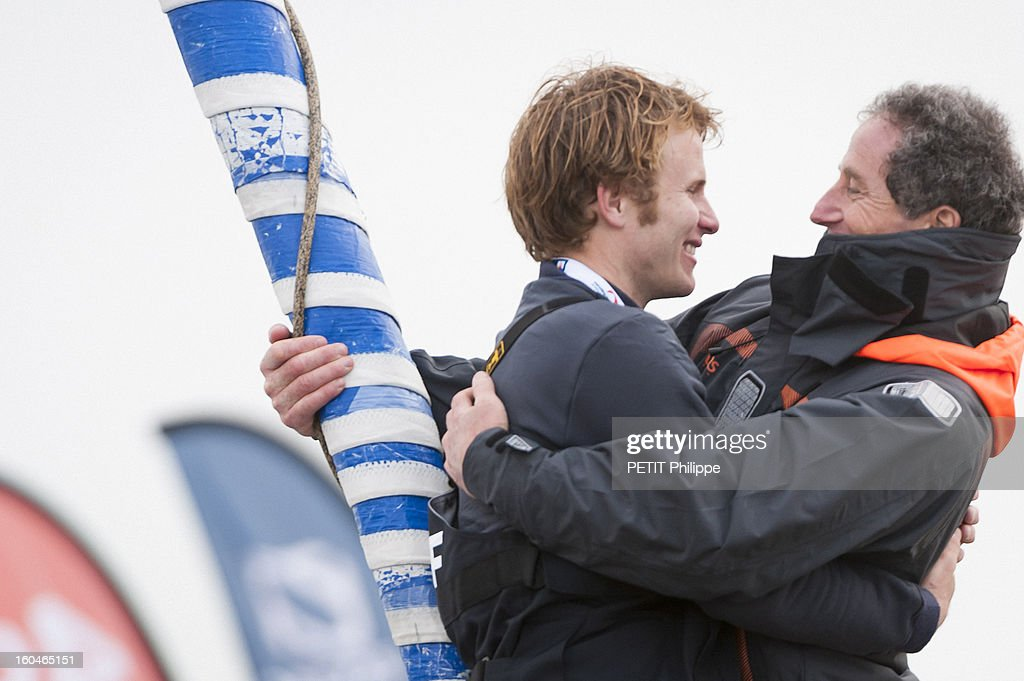 Sailor Francois Gabart is congratulated by Michel Desjoyeaux former winner of the race after arriving in port after winning the Vendee Globe 2013 record with his boat Macif on January 27, 2013 in Sables d'Olonne,France. He won the Vendee Globe 2013, smashing the record round the world solo in 78 days 2 hours and 16 minutes.