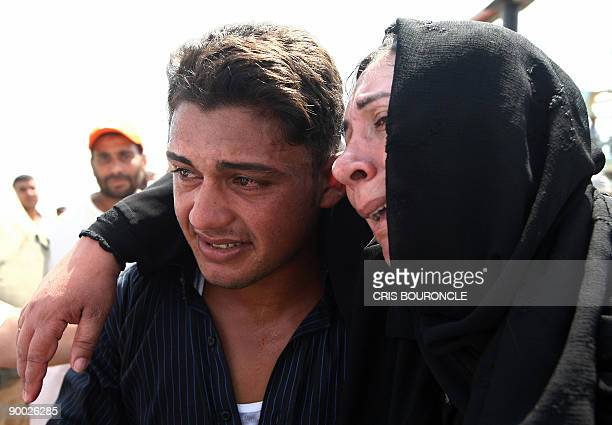A sailor from the Egyptian fishing ship Momtaz I is embraced by his mother upon arrival at Ataka port 170 kms northeast of Cairo on August 23 2009...