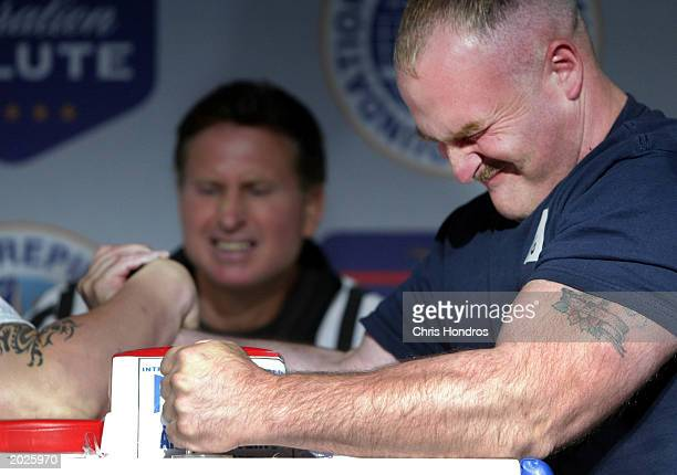 A sailor grimaces during the Annual Fleet Week Team/Ship Arm Wrestling Championships at the Intrepid Museum May 23 2003 in New York City Fleet Week...