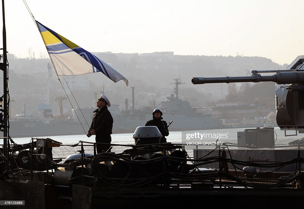 A sailor hoists the Ukrainian flag on the naval ship Ternopil in Sevastopol bay on March 12, 2014. Ukraine will not intervene militarily in the separatist peninsula of Crimea, in order to avoid exposing its eastern border, Ukraine's acting president told AFP Tuesday in an exclusive interview.