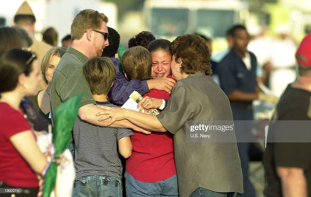 A sailor is reunited with her family at the Naval Air Station October 15, 2000 in Norfolk, VA. 33 Sailors were injured when a suspected terrorist bomb struck the U.S. Navy destroyer USS Cole October 12. Six remaining injured are staying in Ramstein, Germany, until their condition becomes more stable.