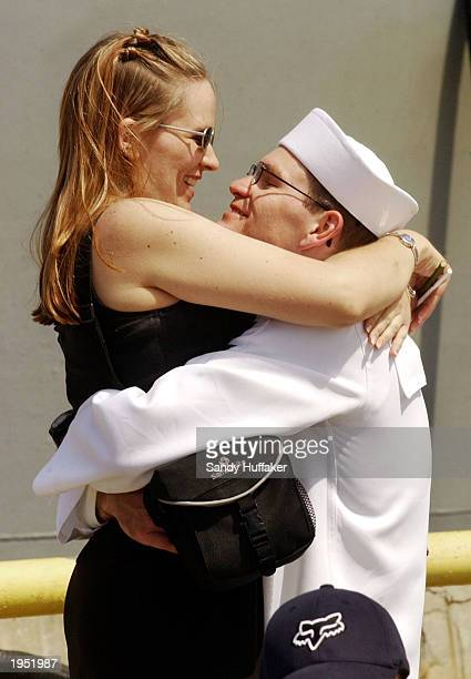 S sailor John Reeder hugs his wife Jill as he returns with the USS Shiloh at Naval Station San Diego April 25 2003 in California The Shiloh and the...