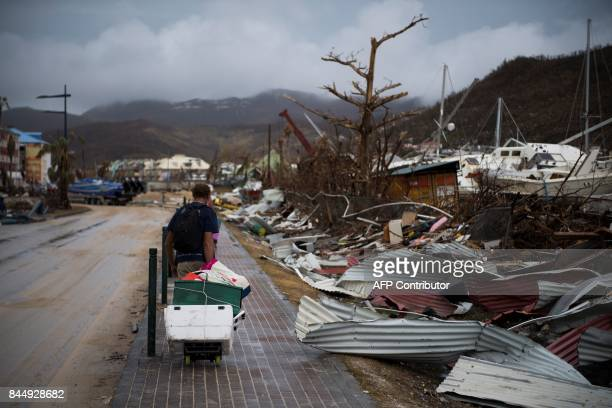 TOPSHOT A sailor leaves with his belongings after loosing his boat in Marigot on September 9 2017 in SaintMartin island devastated by Irma hurricane...