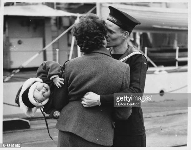 Sailor on Christmas leave returning to his family in Portsmouth England 1953