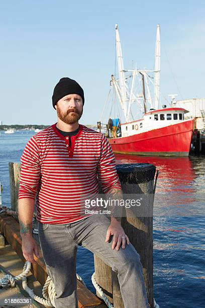 Sailor on Dock with Red Boat