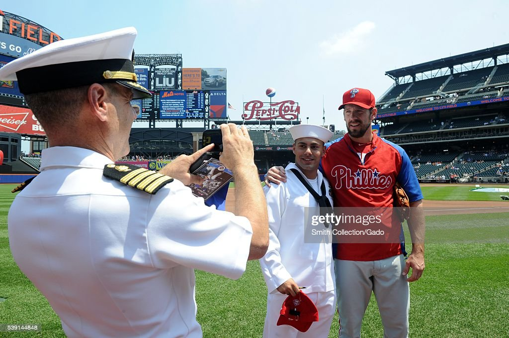 A Sailor poses with Philadelphia Phillies pitcher Cliff Lee before the 5th Annual Military Appreciation game at Citi Field during Fleet Week New York...