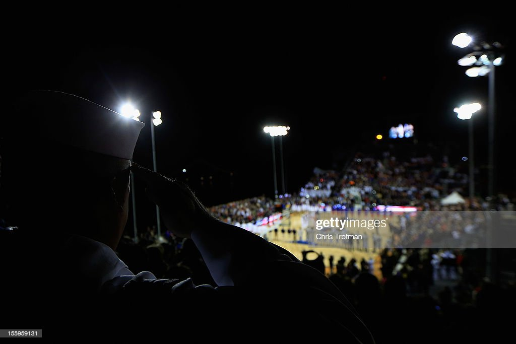 A sailor stands and salutes during the national anthem prior to the Navy-Marine Corps Classic game between the Florida Gators and the Georgetown Hoyas at Mayport Naval Air Station on November 9, 2012 in Jacksonville, Florida.