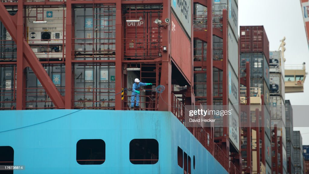 A sailor throws the lines of the world's biggest container ship, the Maersk MC-Kinney Moller as it arrives at the port of Bremerhaven on August 18, 2013 in Bremerhaven, Germany. The world's largest container ship, the Maersk MC-Kinney Moller, arrives at the port of Bremerhaven on Sunday. It has a length of 400 meters, it is 59 meters wide and is capable of delivering 18.000 TEU Container. The ship carries the first Triple-E Standard (Economy of Scale, Energy Efficiency, Environmentally-improved) and is the most efficient and energy saving container ship in the world.