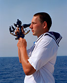Sailor using sextant