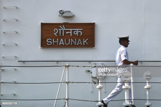 A sailor walks on deck as Indian Coast Guard Ship Shaunak a new offshore patrol vessel arrives at port in Chennai on March 19 making her maiden visit...