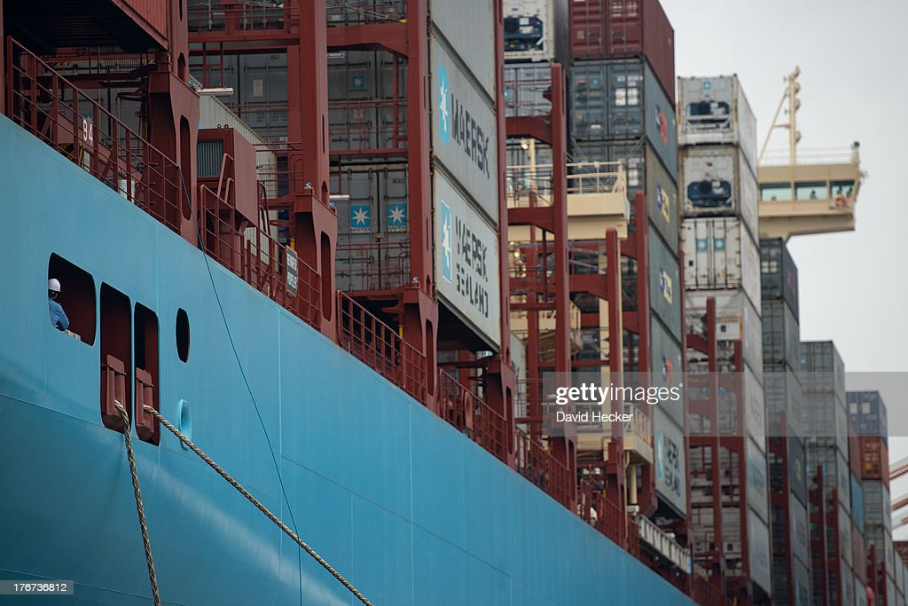 A sailor watches the lines of the world's biggest container ship, named the Maersk MC-Kinney Moller, at the port of Bremerhaven, Germany on August 18, 2013. The ship has a length of 400 meters, it is 59 meters wide and is capable of delivering 18.000 TEU Container. The ship carries the first Triple-E Standard (Economy of Scale, Energy Efficiency, Environmentally-improved) and is the most efficient and energy saving container ship in the world.