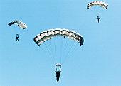 Sailors and airmen parachuting during training exercise