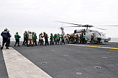 Pacific Ocean, March 19, 2011 - Sailors and Marines aboard the aircraft carrier USS Ronald Reagan (CVN-76) load humanitarian assistance supplies onto a HH-60H Sea Hawk helicopter. USS Ronald Reagan is