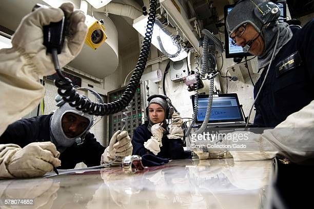 Sailors assigned to USS Porter DDG 78 fight the ship from damage control central during a general quarters drill in the Black Sea Image courtesy Mass...