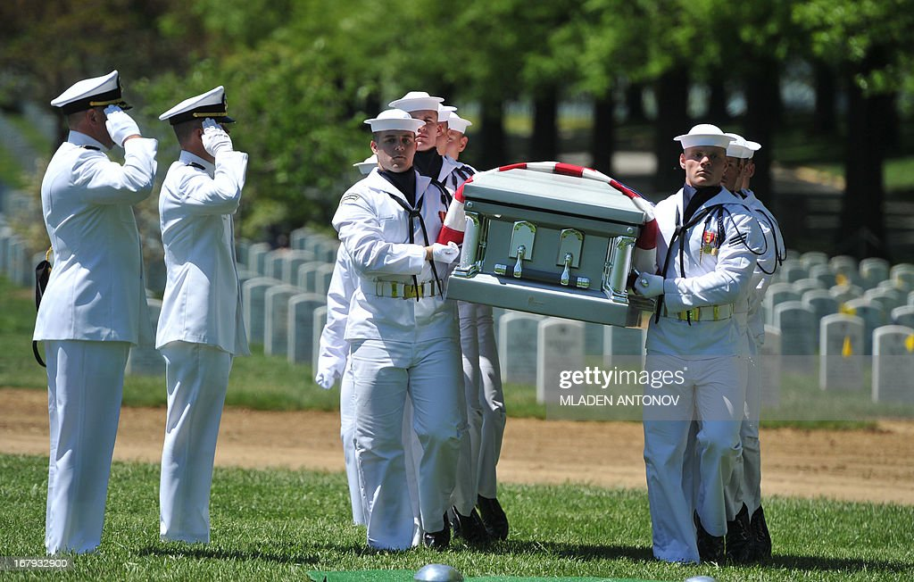 Sailors carry the casket with the remains of four missing US Navy Sailors from the Vietnam War during a burial service at Arlington National Cemetery, May 02, 2013 in Arlington, Virginia. The remains of Lt. Dennis Peterson, Ensign Donald Frye, and Aviation Antisubmarine Warfare Technicians William Jackson and Donald McGrane were buried in a single casket.