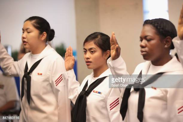 Sailors currently serving in the US Navy at Naval Station Great Lakes take the Oath of Allegiance to become a US Citizen on September 15 2017 in...