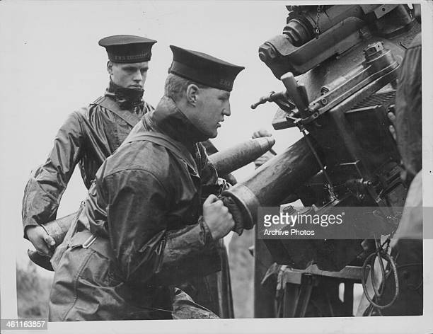 US sailors directing a 4inch antiaircraft gun against German bombers during World War Two France circa 19411945