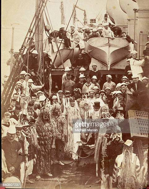 Sailors dress up as King Neptune and other characters during a Neptune Party celebrating crossing the Equator ca 18701890