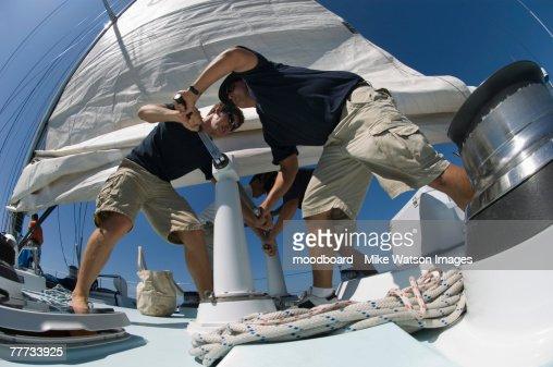 Sailors During Yacht Race Raising Sail