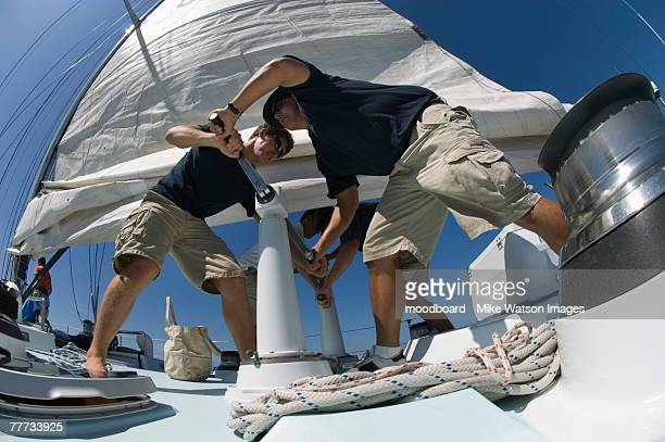 Sailors During Yacht Race Raising Sail