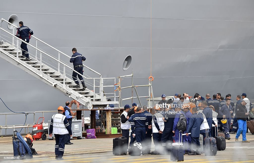 Sailors embark the Gamal Abdl Nasser (ex-Vladivostok) Mistral class ship for a one week training session on May 6, 2016 in Saint-Nazaire, western France. The 'Nasser', first one of the two Mistral class ships sold by France to Egypt after its first sale cancellation to Russia, leaves Saint-Nazaire (Loire-Atlantique) on Friday for a week of Egyptian crew training at sea. / AFP / LOIC
