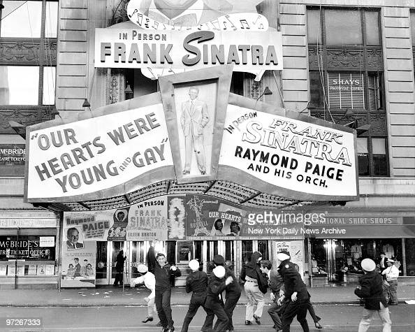Sailors follow up a civilian's egging of Frank Sinatra during Saturday night performance by shelling his picture with tomatoes in front of Paramount...