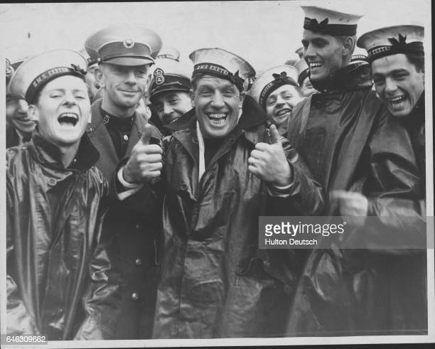 Sailors from HMS Exeter laughing and cheering