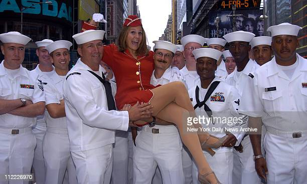 Sailors from the Destroyers USS Mahan and USS Carney here in NYC for Fleet Week give a lift to USO singer dancer Trooper Genna Griffith in Times...