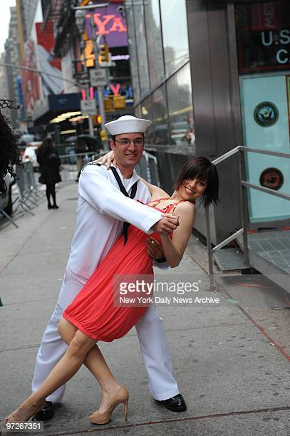 Sailors from the USS Leyte Guld meet cast members from'Iin the Heights' Thursday in Times Square as part of the Fleet Week celebration They are...
