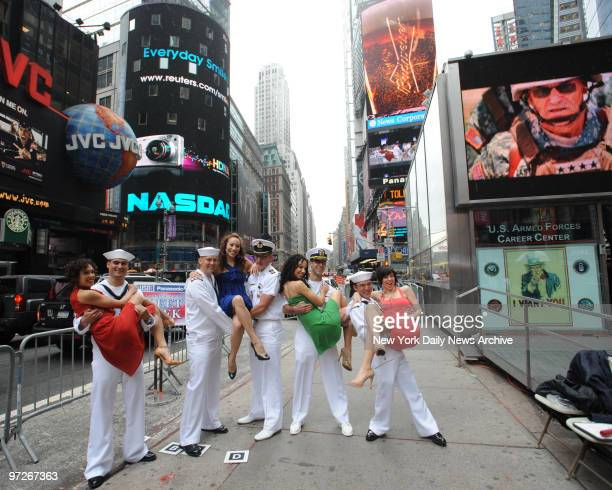 Sailors from the USS Leyte Guld meet cast members from'Iin the Heights' Thursday in Times Square as part of the Fleet Week celebration They are left...