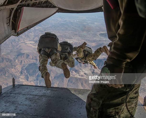 Sailors jump out of a C2-A Greyhound.