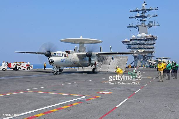 Sailors launch an E2C Hawkeye from the Bluetails of Carrier Airborne Early Warning Squadron VAW 121 on the flight deck aboard the Nimitzclass...