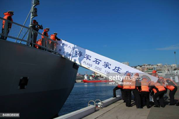 Sailors lay down a gangway from the Shijiazhuang a type 051C missile destroyer of China's People's Liberation Army Navy following the ship's arrival...