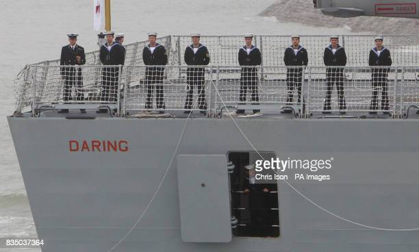 Sailors line the deck of the Royal Navy's newest warship HMS Daring as she sails into Portsmouth Harbour for the first time The 7350tonne ship will...