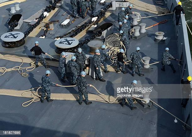 Sailors man the forecastle aboard USS Mesa Verde.