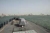 Sailors man the rails as the Arleigh Burkeclass guidedmissile destroyer USS Nitze DDG 94 exits Bahrain following a regularly scheduled port visit...