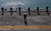 Sasebo, Japan, April 14, 2011 - Sailors man the rails on the amphibious assault ship USS Essex. Essex is returning to Sasebo after completing a three-month patrol of the western Pacific Ocean, which i