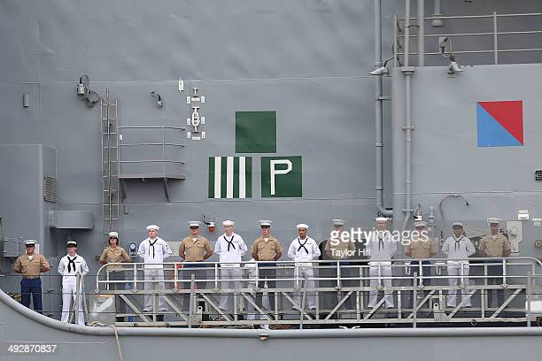 Sailors man the rails on the USS Oak Hill as it arrives for Fleet Week before 'The Last Ship' New York Fleet Week screening at Pier 92 on May 21 2014...