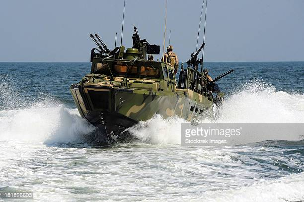 Sailors navigate the waters in a riverine command boat.