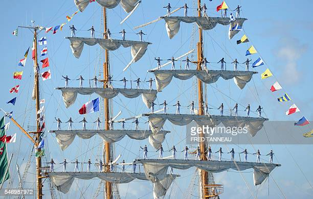 Sailors of the Mexican boat Cuauhtemoc stand on the mats in the port of Brest western France on July 13 on the first day of the Brest 2016 Maritime...