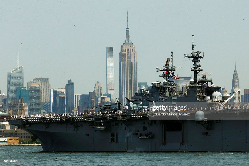 Sailors on board of USS Bataan (LHD 5) arrive in New York Harbor for Fleet Week on May 25, 2016 in New York City. Nearly 4,500 Sailors, Marines and Coast Guardsmen will participate during Fleet Week New York (FWNY) this year. General public ship tours will be conducted daily throughout the week in Manhattan, Brooklyn and Staten Island.