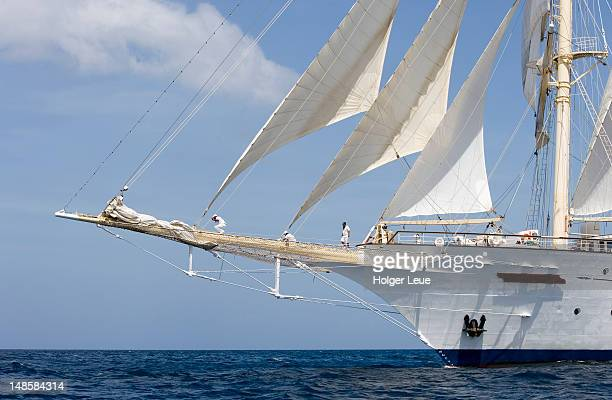 Sailors on bowsprit of cruiseship Star Clipper.