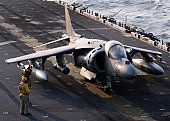 South China Sea, November 20, 2010 - Sailors prepare an AV-8B Harrier jet aircraft for take-off from the forward-deployed amphibious assault ship USS Essex (LHD 2). Essex is part of the forward-deploy