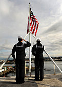 March 24, 2011 - Sailors aboard the aircraft carrier USS Abraham Lincoln (CVN-72) raise the national ensign as the ship moors into its homeport of Everett, Washington.