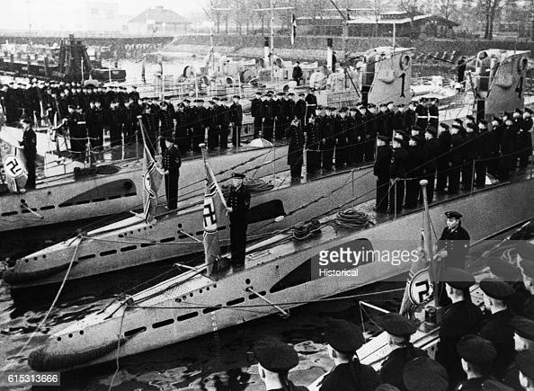 Sailors raise the new war flag of the Third Reich on submarines in Kiel
