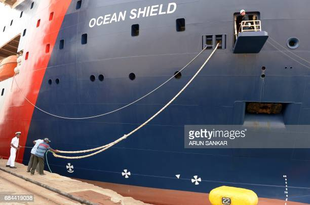 Sailors stand onboard the Australian Border Force Cutter 'Ocean Shield' as she docks in the Indian city of Chennai on May 18 2017 Australian Border...
