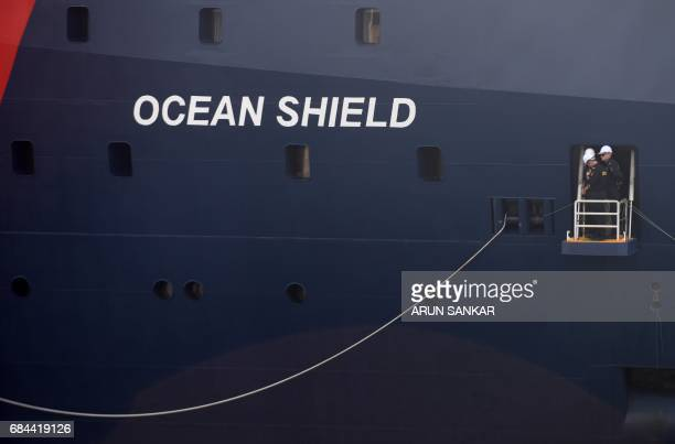 Sailors stand onboard the Australian Border Force Cutter 'Ocean Shield' as she arrives at port in the Indian city of Chennai on May 18 2017...
